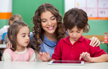teacher and kids ipad shutterstock_143745238